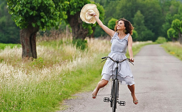 girl-on-bicycle-in-the-country